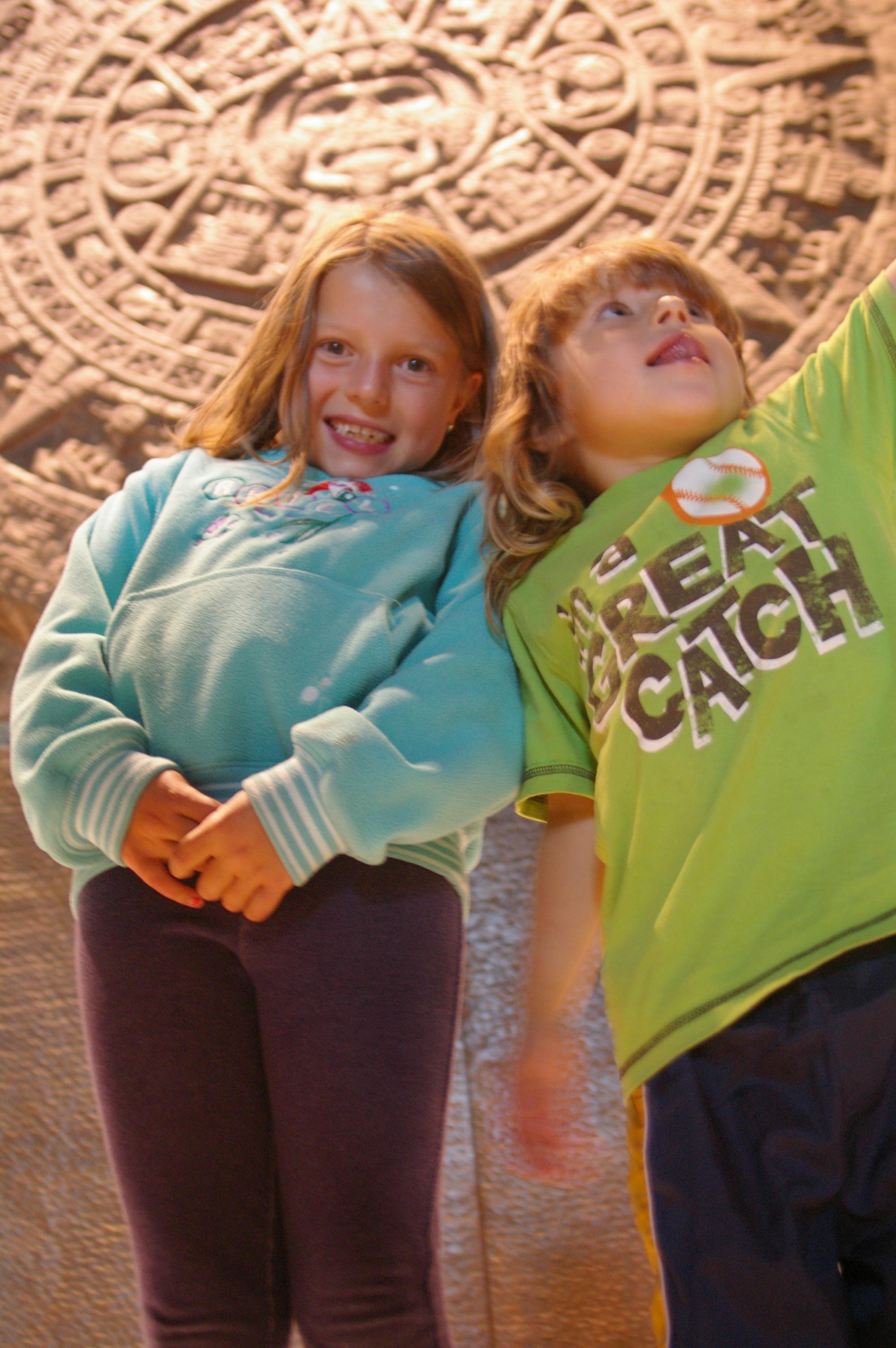 Nadia and Alex standing under the Piedra del Sol.